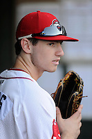 Center fielder Danny Mars (12) of the Greenville Drive sits in the dugout before his first home Class A game against the Charleston RiverDogs on Thursday, August 21, 2014, at Fluor Field at the West End in Greenville, South Carolina. Mars is a sixth-round pick of the Boston Red Sox in the 2014 First-Year Player Draft out of Chipola College. Charleston won, 12-0. (Tom Priddy/Four Seam Images)