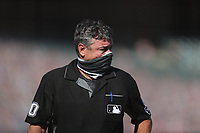 SAN FRANCISCO, CA - SEPTEMBER 27:  Home plate umpire Rob Drake walks off the field after he called Austin Slater #13 of the San Francisco Giants out on strikes in the bottom of the 9th inning of their game against the San Diego Padres to end the game and the season at Oracle Park on Sunday, September 27, 2020 in San Francisco, California. (Photo by Brad Mangin)