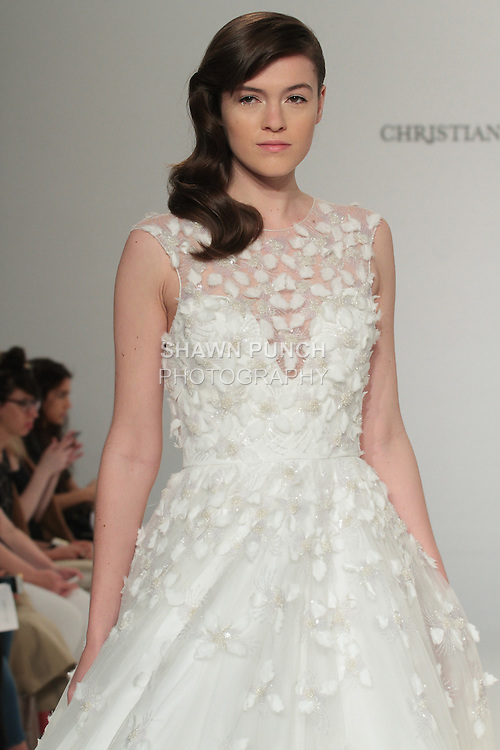 Model walks runway in an embroidered tulle ball gown, from the Christian Siriano for Kleinfeld bridal collection, at Kleinfeld on April 18, 2016 during New York Bridal Fashion Week Spring Summer 2017.