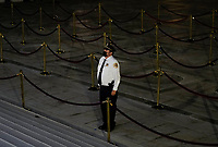 A security guard walks back over to pay respects before the casket of Justice Ruth Bader Ginsburg is moved inside from the top of the front steps of the U.S. Supreme Court building on Thursday, Sept. 24 2020, in Washington. Ginsburg, 87, died of cancer on Sept. 18. <br /> Credit: Andrew Harnik / Pool via CNP /MediaPunch<br /> CAP/MPI/RS<br /> ©RS/MPI/Capital Pictures