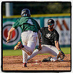 Chandler Kelley (4) of the University of South Carolina Upstate Spartans Green team is caught stealing second as Jason Matthews (11) handles the throw in the Green and Black Fall World Series Game 3 on Sunday, November 1, 2020, at Cleveland S. Harley Park in Spartanburg, South Carolina. Green won, 3-2. (Tom Priddy/Four Seam Images)