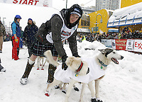 Saturday, March 3, 2012  Wade Marrs and his dog Louie (right) at the start line of the Ceremonial Start of Iditarod 2012 in Anchorage, Alaska.