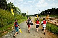 Summer campers participate in high adventure activities, including mountain biking, at the U.S. National Whitewater Center in Charlotte, NC. The USNWC is a non-profit outdoor recreation center on 400 acres adjacent to the Catawba River. The whitewater center is an athletic training facility for whitewater rafting and whitewater slalom racing, kayaking, canoeing, rock climbing, mountain biking and hiking. The primary feature of the USNWC is the world's largest and most-complex recirculating artificial whitewater river, which was designed by Scott Shipley, a three-time Olympian.