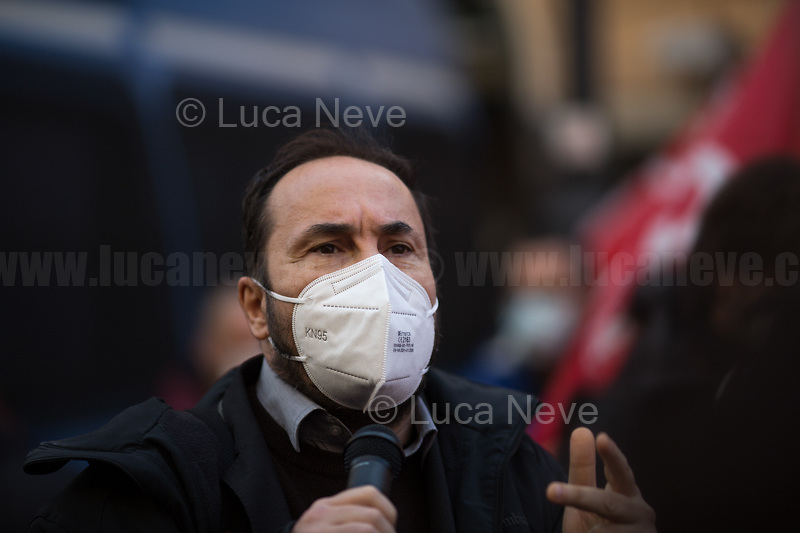 Maurizio Acerbo (Secretary of Rifondazione Comunista).<br /> <br /> Rome, Italy. 18th Feb 2021. Today, the Trade Union Si Cobas, Potere Al Popolo Party, Rifondazione Comunista Party and other organizations of the non-parliamentarian Left held a rally (1.) in Piazza San Silvestro to protest against the new Italian Government led by the former President of the European Central Bank, BCE, Professor Mario Draghi (2. 3.). From the organisers Facebook event page: «[…] We call to mobilize male and female workers, the unemployed, the precarious, the students, the popular classes and all the associations and people who struggle, who do not want to stand by while a government that is directed expression of a united bosses front is ready to strike us with anti-people policies. It is time to join the fight against the government of banks and bosses: we will not pay for this crisis! […]». The demo ended peacefully, even though there were moments of tension between protesters and full riot gears police officers due to demonstrators aimed to march to the Parliament.<br /> <br /> Footnotes & Links:<br /> 1. https://www.facebook.com/events/4966336456769715<br /> 2. 13.02.2021 - Mario Draghi's New Italian Government Swears At Quirinale Palace http://bit.do/fNPQ5<br /> 3. 17.02.2021 - Italian Prime Minister Mario Draghi Arrives at Italian Senate http://bit.do/fNPRc