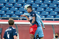 FOXBOROUGH, MA - SEPTEMBER 19: Brandon Bye #15 of New England Revolution and Valentin Castellanos #11 of New York City FC battle for a head ball during a game between New York City FC and New England Revolution at Gillette on September 19, 2020 in Foxborough, Massachusetts.