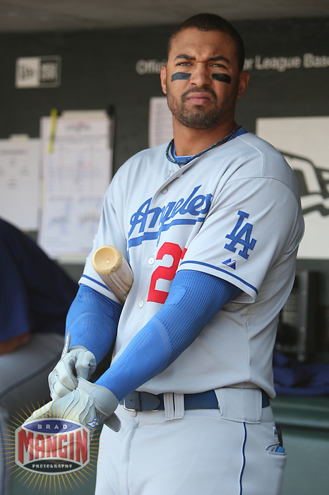 SAN FRANCISCO - JULY 6:  Matt Kemp of the Los Angeles Dodgers gets ready to bat in the dugout during the game against the San Francisco Giants at AT&T Park in San Francisco, California on July 6, 2008.  The Dodgers defeated the Giants 5-3.  Photo by Brad Mangin