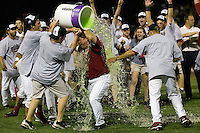 The South Carolina Gamecocks celebrate by dousing coach Ray Tanner after winning the NCAA Division One Men's College World Series on June 29th, 2010 at Johnny Rosenblatt Stadium in Omaha, Nebraska.  (Photo by Andrew Woolley / Four Seam Images)