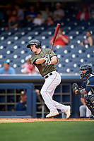 Nashville Sounds designated hitter Mark Canha (16) follows through on a swing during a game against the New Orleans Baby Cakes on April 30, 2017 at First Tennessee Park in Nashville, Tennessee.  The game was postponed due to inclement weather in the fourth inning.  (Mike Janes/Four Seam Images)