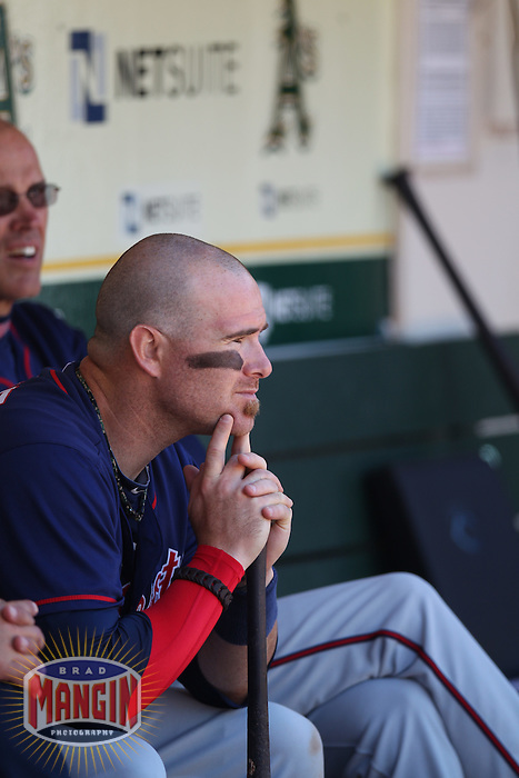 OAKLAND, CA - AUGUST 22:  Ryan Doumit #18 of the Minnesota Twins sits in the dugout during the game against the Oakland Athletics at O.co Coliseum on Wednesday, August 22, 2012 in Oakland, California. Photo by Brad Mangin