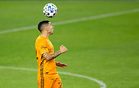CARSON, CA - OCTOBER 28: Matias Vera #22 of the Houston Dynamo heads a ball during a game between Houston Dynamo and Los Angeles FC at Banc of California Stadium on October 28, 2020 in Carson, California.
