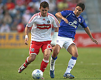 Chicago Fire defender Gonzalo Segares (25) dribbles the ball away from Everton midfielder Mikel Arteta (10).  The Chicago Fire defeated English Premier League Team Everton FC 2-0 in a friendly match at Toyota Park in Bridgeview, IL, on July 30, 2008.