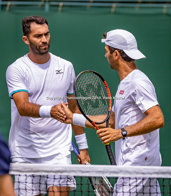 London, England, 5 July, 2019, Tennis,  Wimbledon, Men's doubles: Jean-Julien Rojer (NED) and Horia Tecau  (ROU) (L) celebrate<br /> Photo: Henk Koster/tennisimages.com