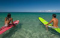 Surfers at Hapuna Beach on the Big Island of Hawaii