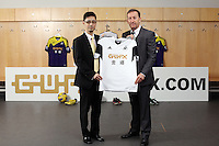 Pictured: Albert Sin of Goldenway with club chairman Huw Jenkins. <br /> Re: Official launch of the 2013-2014 Swansea City Football Club kit launch, with sponsors Goldenway GWFX at the Liberty Stadium, Swansea, south Wales. Friday 28th of June 2013
