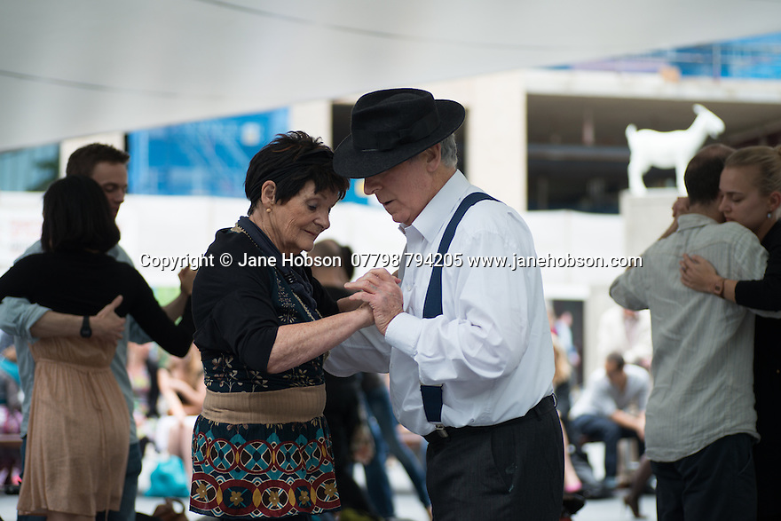London, UK. 15.06.2014. London's Tango community assembled for Tango@Spitalfields Outdoor Milonga (Liverpool St), with music played by<br /> DJ Jalal Kadkani (London) as part of the London Tango Long Weekend, World Cup Edition (4th Edition). The weekend is organised by Hiba Faisal, and Rene Hellemons, of Tango Fever. Photograph © Jane Hobson.