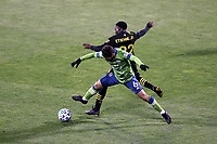 COLUMBUS, OH - DECEMBER 12: Joao Paulo #6 of the Seattle Sounders FC and Derrick Etienne Jr #22 of the Columbus Crew challenge for the ball during a game between Seattle Sounders FC and Columbus Crew at MAPFRE Stadium on December 12, 2020 in Columbus, Ohio.