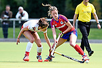 Mannheim, Germany, April 18: During the 1. Bundesliga Damen match between TSV Mannheim (white) and Mannheimer HC (red) on April 18, 2015 at TSV Mannheim in Mannheim, Germany. Final score 1-7 (1-4). (Photo by Dirk Markgraf / www.265-images.com) *** Local caption *** Pauline Wenzel #6 of TSV Mannheim, Antonia Hering #34 of Mannheimer HC