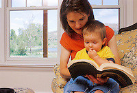 60.2 MB File  Model Released  Woman reading to her child.