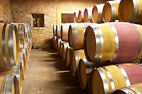 Oak barrique barrels with aging red wine Chateau Belingard Bergerac Dordogne France