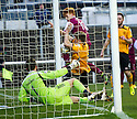 Annan's Peter Watson seems to keep Arbroath's Simon Murray's shot out with his arms.