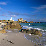 France, Brittany, near Brignogan Plage: View along sandy beach and Pointe de Pontusval Lighthouse