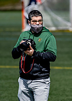 1 May 2021: University of Vermont Catamount Director of Athletic Communications & Broadcasting Nich Hall, takes photographs prior to a game against the Stony Brook University Seawolves at Virtue Field in Burlington, Vermont. The Cats edged out the Seawolves 14-13 with less than one second to play in their America East Men's Lacrosse matchup. Mandatory Credit: Ed Wolfstein Photo *** RAW (NEF) Image File Available ***