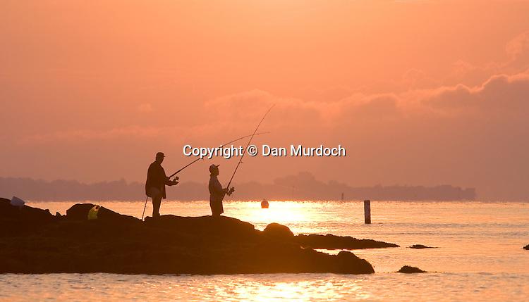 fishing off the rocks at sunrise