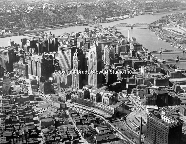 Pittsburgh PA:  With the start of Renaissance 1 (1946), Brady Stewart Studio photographed the Pittsburgh skyline with every major improvement. Aerial photograph of the city of Pittsburgh and the three rivers.