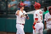 Memphis Redbirds catcher Carson Kelly (19) is congratulated by Harrison Bader (3) as he returns to the dugout after hitting a home run in the bottom of the fourth inning during a game against the Round Rock Express on April 28, 2017 at AutoZone Park in Memphis, Tennessee.  Memphis defeated Round Rock 9-1.  (Mike Janes/Four Seam Images)