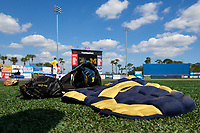 Michigan Wolverines catchers gear in the grass before a game against Army West Point on February 17, 2018 at Tradition Field in St. Lucie, Florida.  Army defeated Michigan 4-3.  (Mike Janes/Four Seam Images)