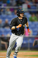 Akron RubberDucks third baseman Eric Stamets (12) runs to first base during a game against the Binghamton Rumble Ponies on May 12, 2017 at NYSEG Stadium in Binghamton, New York.  Akron defeated Binghamton 5-1.  (Mike Janes/Four Seam Images)