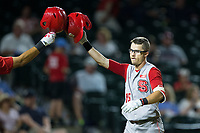 Josh McLain (15) of the North Carolina State Wolfpack knocks helmets with a teammate after hitting a solo home run against the North Carolina Tar Heels in Game Twelve of the 2017 ACC Baseball Championship at Louisville Slugger Field on May 26, 2017 in Louisville, Kentucky.  The Tar Heels defeated the Wolfpack 12-4 to advance to the semi-finals.  (Brian Westerholt/Four Seam Images)