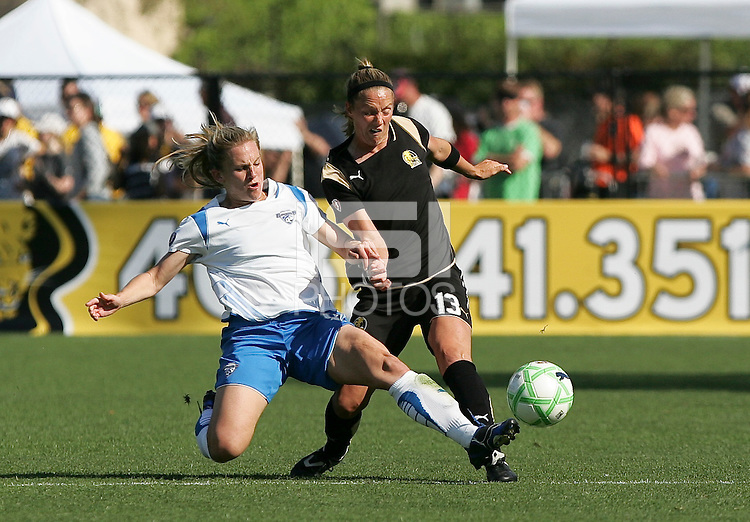 Amy Rodriguez (left) slide tackles Kristen Graczyk (13). FC Gold Pride defeated the Boston Breakers 2-1 at Buck Shaw Stadium in Santa Clara, California on April 5th, 2009. Photo by Kelley Cox /isiphotos.com