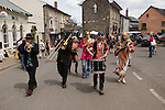 Members of Giffords circus parade through the town to attract attention for that afternoons performance. The Hay Festival, Hay on Wye, Powys, Wales, Great Britain. 2006.