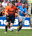 Dundee Utd's Ryan Gauld gets away from St Johnstone's Patrick Cregg.