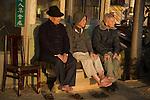 Three senior men friends sitting outside a shop, Danshui, Taipei County, Taiwan