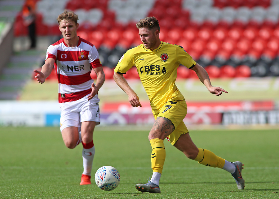 Fleetwood Town's Wes Burns gets away from Doncaster Rovers' Kieran Sadlier<br /> <br /> Photographer David Shipman/CameraSport<br /> <br /> The EFL Sky Bet League One - Doncaster Rovers v Fleetwood Town - Saturday 17th August 2019  - Keepmoat Stadium - Doncaster<br /> <br /> World Copyright © 2019 CameraSport. All rights reserved. 43 Linden Ave. Countesthorpe. Leicester. England. LE8 5PG - Tel: +44 (0) 116 277 4147 - admin@camerasport.com - www.camerasport.com