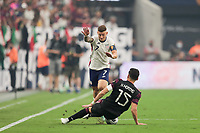 LAS VEGAS, NV - AUGUST 1: Paul Arriola #7 of the United States is defended by Hector Moreno #15 of Mexico during a game between Mexico and USMNT at Allegiant Stadium on August 1, 2021 in Las Vegas, Nevada.