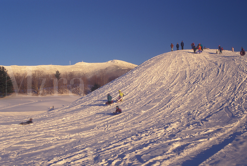 sledding, Vermont, VT, People sledding down a snow-covered hill in Underhill Center in winter.