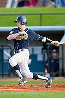 Zach Leach (20) of the UNCG Spartans follows through on his swing against the Georgia Southern Eagles at UNCG Baseball Stadium on March 29, 2013 in Greensboro, North Carolina.  The Spartans defeated the Eagles 5-4.  (Brian Westerholt/Four Seam Images)