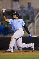 Andy Ibanez (7) of the Hickory Crawdads swings and misses during the game against the Kannapolis Intimidators at Kannapolis Intimidators Stadium on April 9, 2016 in Kannapolis, North Carolina.  The Crawdads defeated the Intimidators 6-1 in 10 innings.  (Brian Westerholt/Four Seam Images)