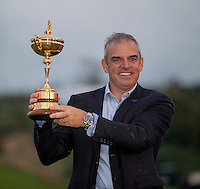 28.09.2014. Gleneagles, Auchterarder, Perthshire, Scotland. The Ryder Cup, final day.  Paul McGinley European Team Captain celebrates with the Ryder Cup after Sunday Singles.  Europe won sixteen and a half points to eleven and a half points.