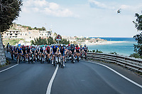 peloton rolling along the Mediterranean <br /> <br /> 112th Milano-Sanremo 2021 (1.UWT)<br /> 1 day race from Milan to Sanremo (299km)<br /> <br /> ©kramon