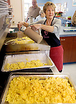 WOLCOTT CT. 30 December 2013-123013SV07-Donna Belval, director, scrambles the eggs for brunch at the senior center in Wolcott Monday. The seniors celebrate the New Year with an annual brunch before it closes on Tuesday and Wednesday for the holiday. About 40 seniors attended. <br /> Steven Valenti Republican-American