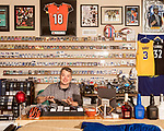 November 27, 2019. Cary, North Carolina.<br /> <br /> Jimmy Mahan uses a sorting tray to organize newly acquired cards and add them to his enormous collection. <br /> <br /> Jimmy Mahan, a former social worker and banker, has a massive collection of sports memorabilia. His collection spans his days as a kid growing up in Kentucky and loving UK basketball all the way through high collectible classic baseball cards, jerseys and sneakers.