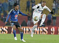 BOGOTA - COLOMBIA -07 -02-2015: Fabian Vargas (Izq) jugador de Millonarios disputa el balón con Alan Navarro (Der) jugador de Patriotas FC, durante partido entre Millonarios y Patriotas FC por la fecha 2 de la Liga Aguila I-2015, jugado en el estadio Nemesio Camacho El Campin de la ciudad de Bogota. / Fabian Vargas (L) player of Millonarios vies for the ball with Alan Navarro (R) player of Patriotas FC, during a match between Millonarios and Patriotas FC for the  date 1 of the Liga Aguila I-2015 at the Nemesio Camacho El Campin Stadium in Bogota city, Photo: VizzorImage / Gabriel Aponte / Staff.