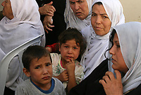 """Palestinian relatives of Mohammed Abu Herbet, 23, react during his funeral at the family house in the town of Beit Hanoun, northern Gaza Strip, Sunday, Nov. 4, 2007. Israeli aircraft fired at a rocket-launching site in the northern Gaza Strip early Sunday, killing three civilians, including Abu Herbet, sleeping in a nearby storage container, Palestinian officials said. The Israeli military said the air strike targeted a rocket squad that attacked southern Israel earlier in the morning. """"phto by Fady Adwan"""""""