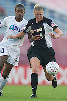 Charmaine Hooper of the Beat and Lauren Orlandos of the Power try to push each other off the ball. The Atlanta Beat and the NY Power played to a 1-1 tie on 7/26/03 at Mitchel Athletic Complex, Uniondale, NY..