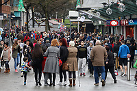 Christmas shoppers in Oxford Street, the main shopping district at the city centre of Swansea, Wales, UK. Friday 22 December 2017