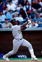 Miguel Tejada of the Oakland Athletics plays in a baseball game at Edison International Field during the 1998 season in Anaheim, California. (Larry Goren/Four Seam Images)